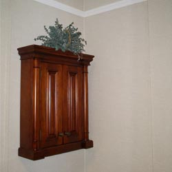 a cabinet mounted on a basement wall