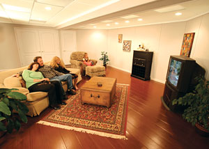 A family enjoying their finished basement living room
