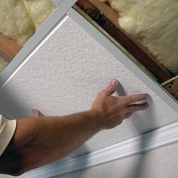 installing ceiling tiles in a finished basement