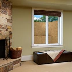 An egress window well and vinyl basement replacement window