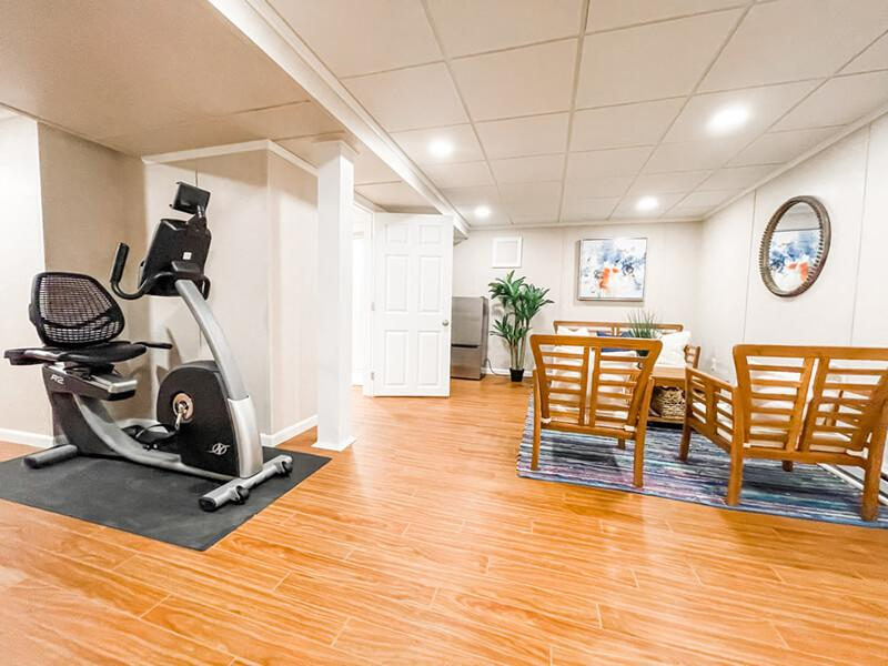 Living space and home gym in a finished basement