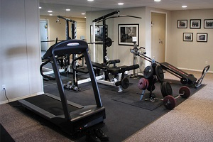 create a home gym in your basement with total basement