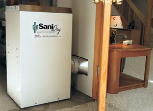A high-capacity dehumidifier, combined with waterproofing as necessary, keeps your basement comfortable and dry. It may be located in a utility closet as shown.