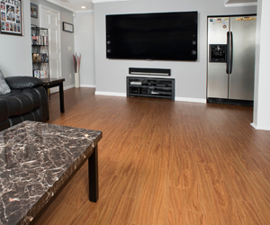 a finished basement with a wood laminate floor