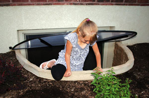 Egress window wells with steps facilitate exiting from the basement during an emergency.