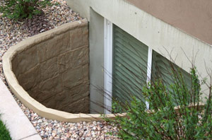 A molded-in, stone texture gives egress window wells a more natural look.