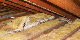 installing spray foam insulation on a rim joist in Lorain