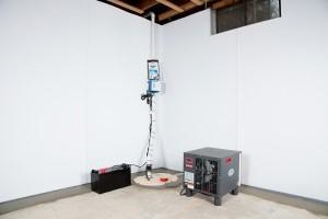 Sump pump and dehumidifier system inside a basement