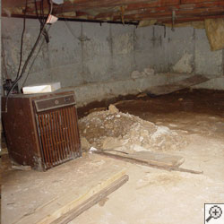 An outdated crawl space dehumidifier running in a vented space.