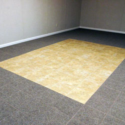 Carpeted basement floor tiles installed on a concrete slab floor.