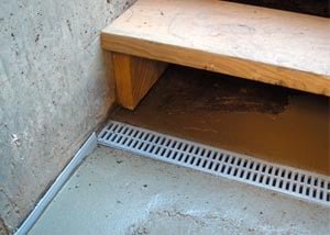 a hatchway entrance protected from flooding by our TrenchDrain basement drainage system.