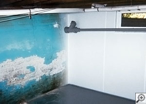 Bare concrete foundation walls in a basement before insulation was installed.