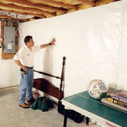 A basement wall vapor barrier system installed in a home.