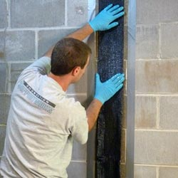 carbon fiber strips installed on a foundation wall that was buckling due to expansive soils