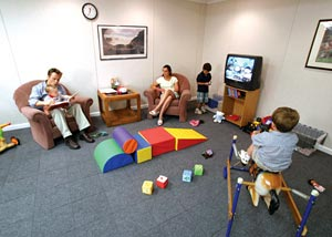 A children's play room in the basement with our carpeted floor tile system installed