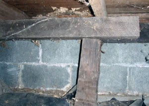 a collapsing crawl space support post