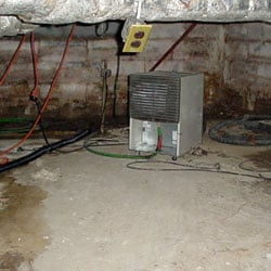 An old dehumidifier located in a crawl space