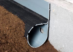 Our crawl space drain system installed in a dirt crawl space
