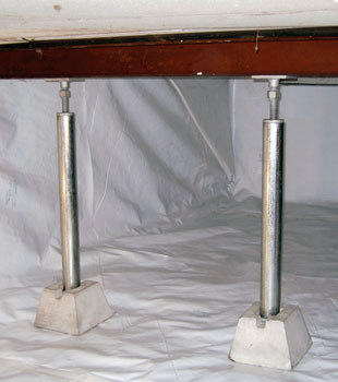 A sealed crawl space with crawl space jack posts installed.