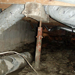 an installation of light-duty crawl space support jacks