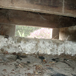 A vented crawl space opening, shown from the inside.
