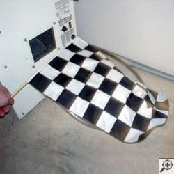 A basement dehumidifier fan blowing a racing flag.