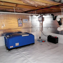 a crawl space dehumidifier installed in a sealed and insulated crawl space