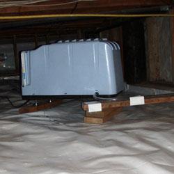 A crawl space dehumidifier system installation