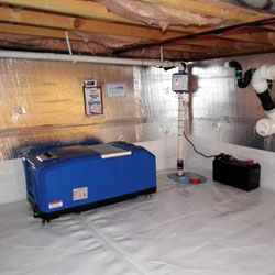 A crawl space dehumidifier system installed and draining to a sump pump.