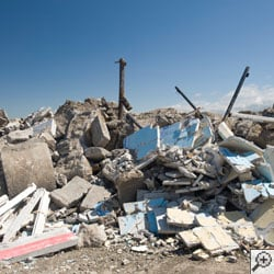 A construction landfill, with concrete, wood, and drywall debris.