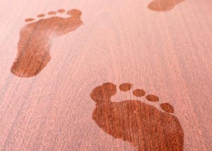 Footprints showing up in the dust on a floor