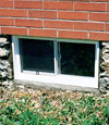 Outside view of one of our vinyl replacement basement windows.