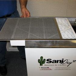 An installed basement dehumidifier system