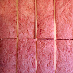 Fiberglass insulation installed in a basement that is being remodeled.