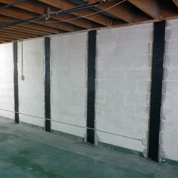 a buckling foundation wall repaired with carbon fiber strips