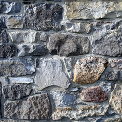 A closeup of a stone basement wall