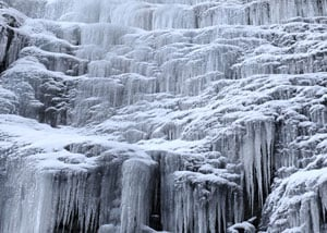 A frozen waterfall, emphasizing how easily a frozen drain can occur with your sump pump system