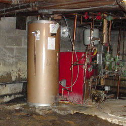 A furnace and water heater stored in a crawl space