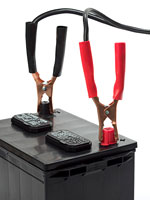 a car battery with jumper cables installed