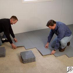 Installation of our waterproof basement floor matting tiles.