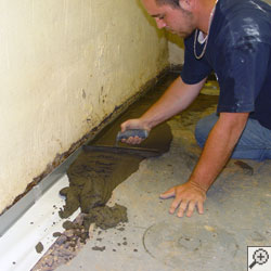 installation of a French drain system in a basement