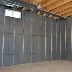 Insulated basement wall panels with built-in studs.