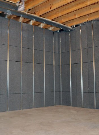 basement wall insulation and studs installed in a prefinished basement