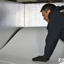 A crawl space contractor installing basement floor insulation