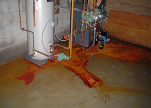Iron ochre laden water on a concrete basement floor, staining everything.