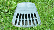 LawnScape™ underground downspout extension discharge grate