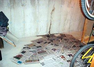 A flooding basement wall crack