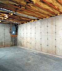 A poured concrete basement wall