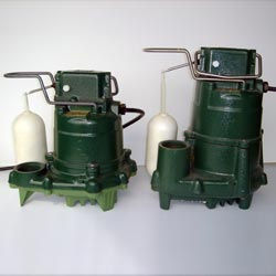two submersible cast-iron Zoeller sump pumps