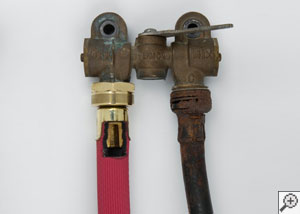 One of our heavy duty washer hoses compared to an old, corroded rubber one.